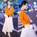 2017 spring women's v-neck orange knitting sweater Pleated +white skirt suits female 2 piece sets