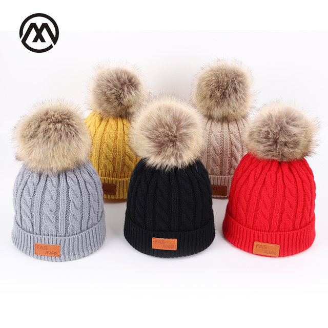 Solid color knitted cotton caps children s autumn and winter kids warm  pompoms ski hats boys and girls universal faux fur Beanie 76a727c382f