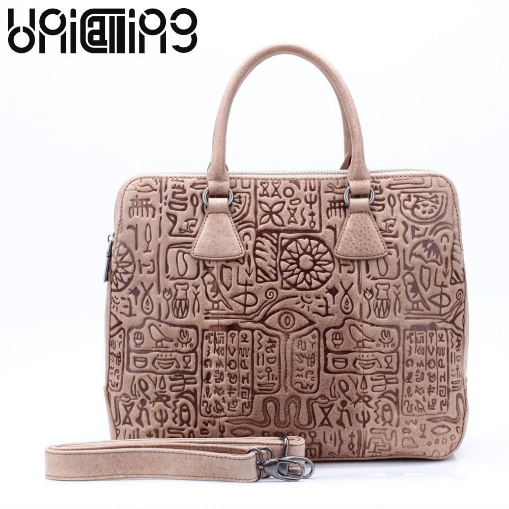UniCalling quality genuine leather women handbag fashion hieroglyphic embossing pattern female tote bag double layer spaceUniCalling quality genuine leather women handbag fashion hieroglyphic embossing pattern female tote bag double layer space
