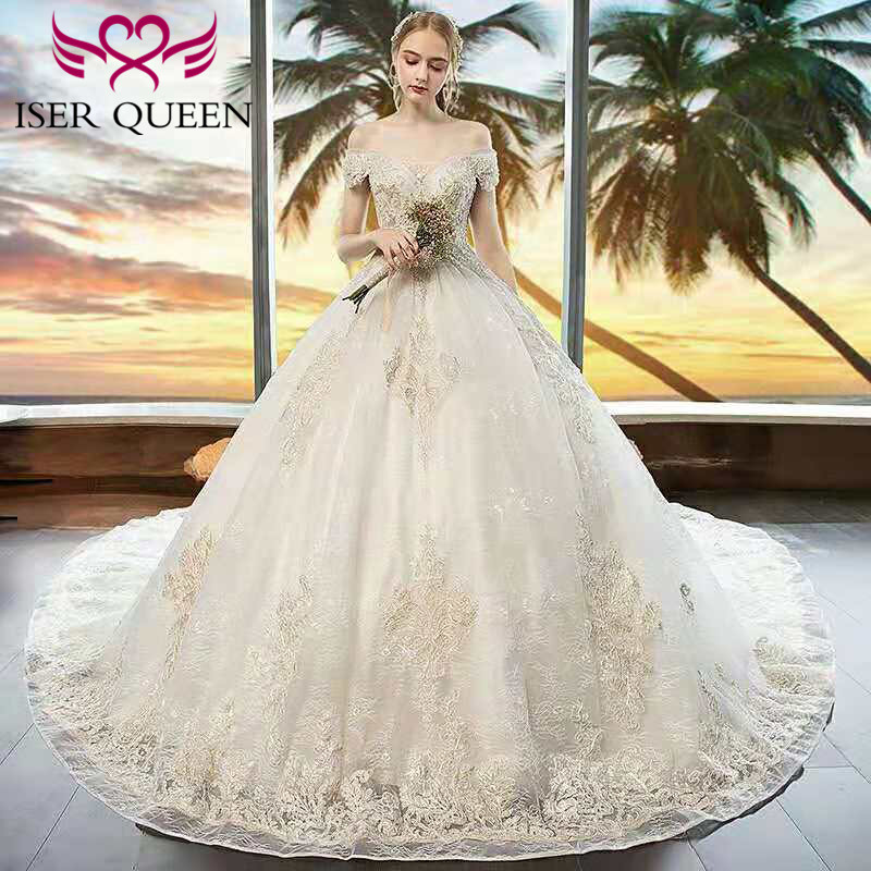 Luxury Cap Sleeves Bright Sequined Beading and Pearls Tulle Embroidery Bridal Gown Champagne Wedding Dresses Ball Gown WX0150