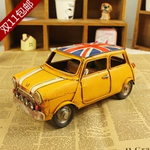 Vintage Old Style Mini Cooper With British Flag On Roof