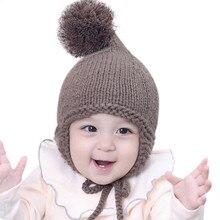 2017 invierno moda bebé lindo earbud sombrero niño niña caliente grueso de  algodón de punto orejas Beanie lana earflap Cap edade. 3c89612bce9