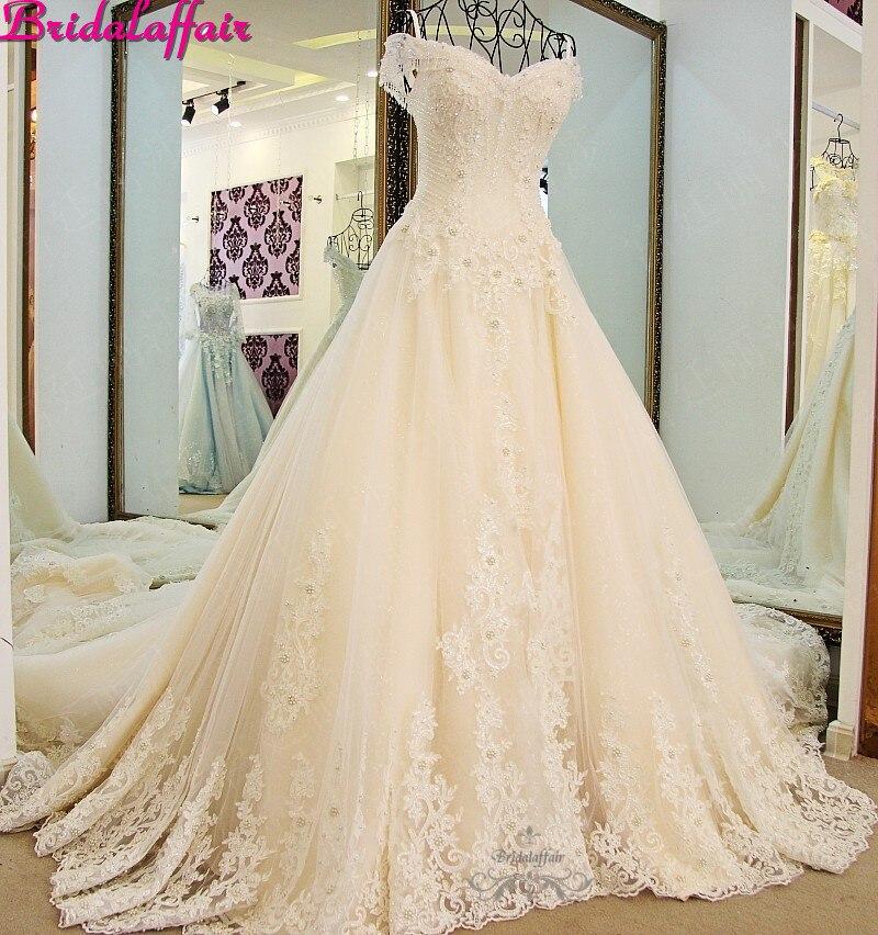 Luxo a linha vestidos de casamento cristal apliques rendas designer vestido de casamento designers trem real vestidos de casamento 2019