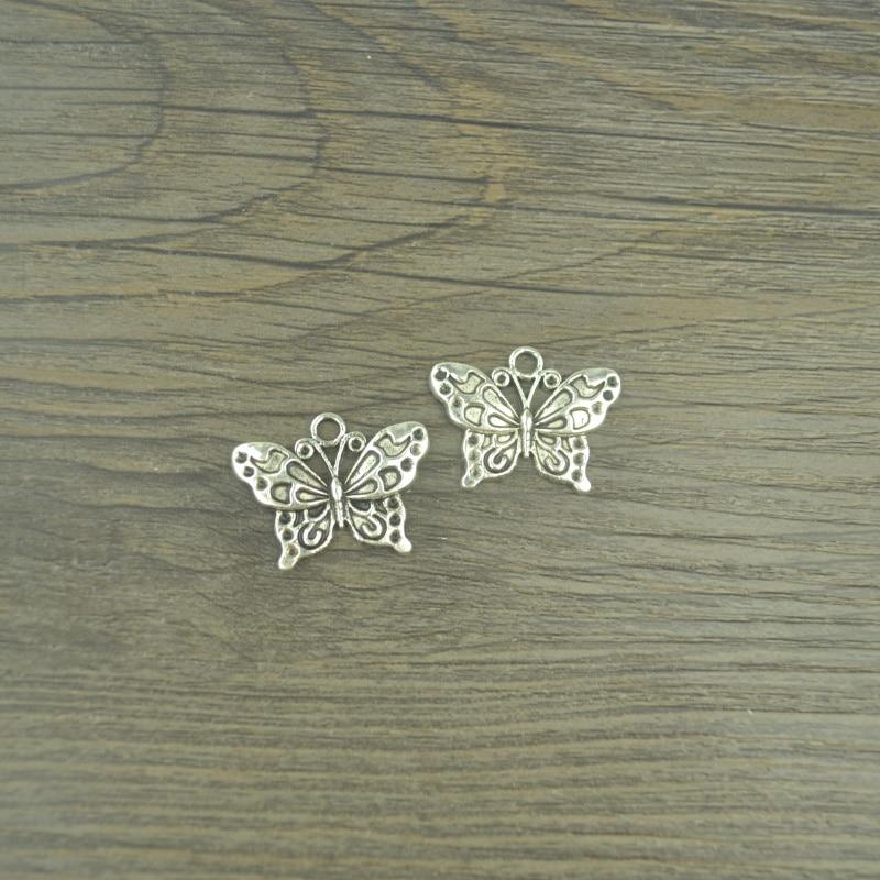 10 Plata tibetana colgante de mariposa encantos 17m X 10mm