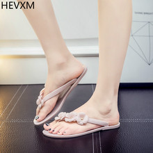 2017 summer new Camellia folder toe Ms. non-slip beach sandals flat jelly word slippers zapatos women's shoes