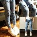Новый Год, весной и осенью ребенок девочка джинсы мода мультфильм свободный стиль джинсовые брюки для девочек детей 3-13 лет