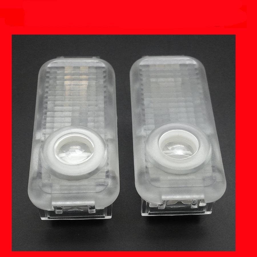 Auto LED welcome door lamp step logo light 3d ghost shadow bulb door light passat Phaeton HD 2pcs a lots
