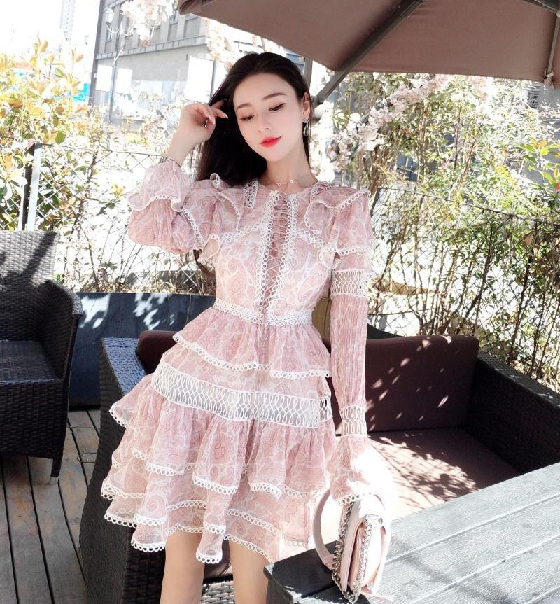 Nouvelle mode 2019 robe d'été femmes Sexy évider Bandage robe dos dentelle Split cascade volants décontracté courte Mini robe