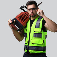 60b8b31a222 Hombre de trabajo chaleco de seguridad destacar cintas reflectantes Multi  bolsillos Tops Mens Tops con ribete negro Bordes de gr.