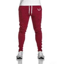 Мужчины Марка эластичный высокое качество уличная мода мужчины случайные брюки спортивные штаны мужчины jogger брюки красный тощий джинса