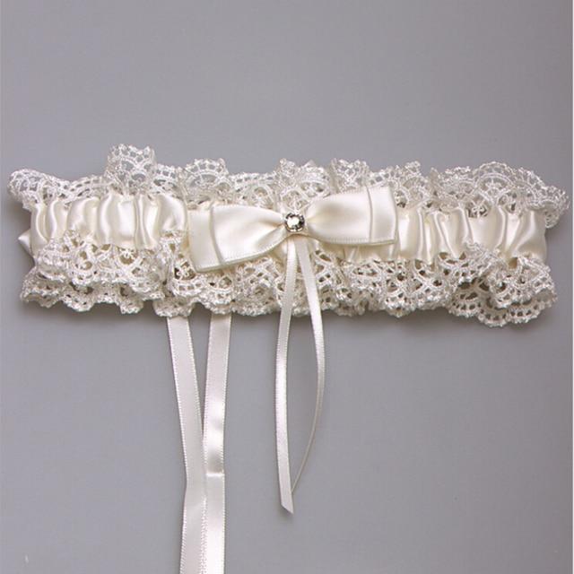 Western style new elegant bowknot lace wedding garter set pearl western style new elegant bowknot lace wedding garter set pearl bridal leg garter belt lace bride junglespirit Gallery
