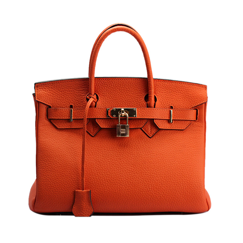 Europe and the United States with a layer of leather embossed platinum Baotou portable leather handbag factory wholesale lock 2017 hot high quality brand baotou layer of cow leather bags the new ms tassel handbag is a 100% leather handbag