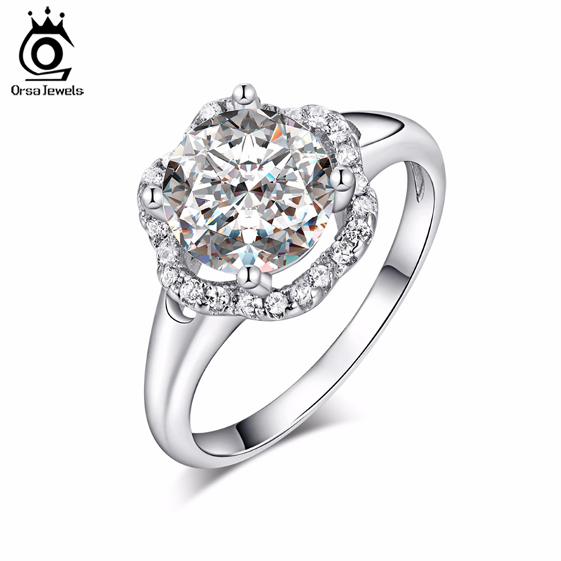 ORSA JEWELS Fashion Jewelry Flower Wedding Ring for Women Engagement Rings with One Big Luxury 2 Carat AAA Cubic Zirconia OR34