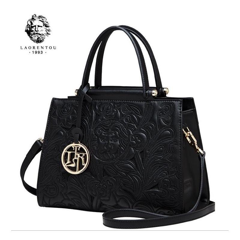 Célèbre marques haut de Vache En Cuir femmes sac D'épaule de Mode Sac de Messager 2018 nouveau style sac à main en relief
