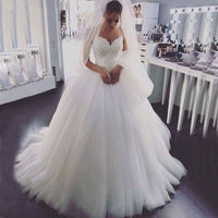 Sexy Spaghetti Strap Wedding Dresses Tulle Court Train Lace Appliques A Line Bridal Gowns
