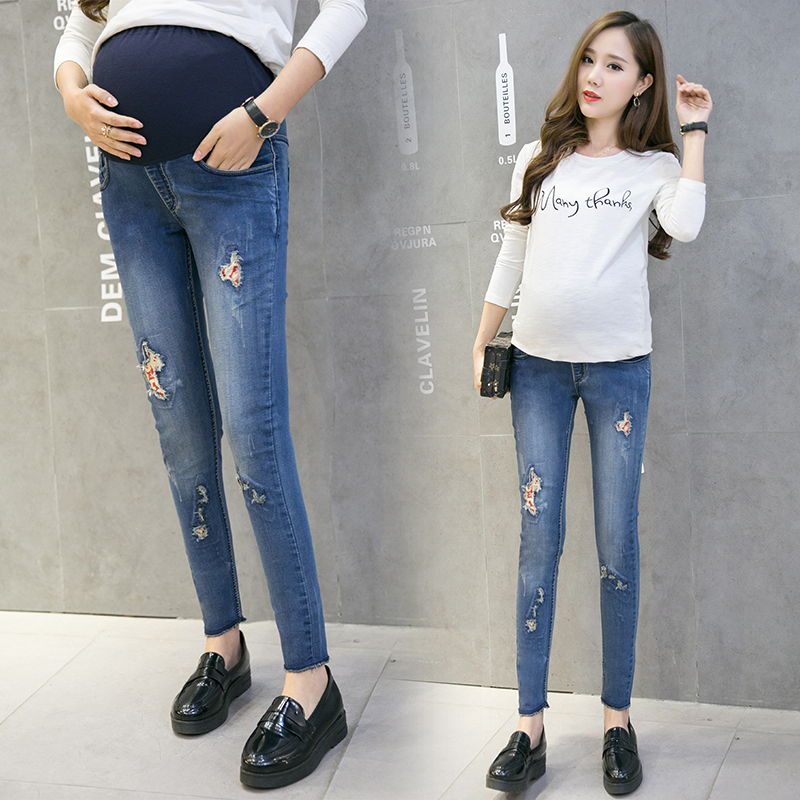 Make the pregnant woman the spring and autumn period and the han edition outside show thin foot pencil the stylish jeans wear lo