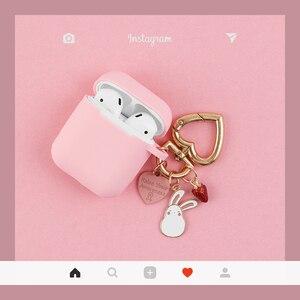 Image 1 - Màu Hồng Dễ Thương Silicone Rung Phụ Kiện Tai Nghe Bluetooth Chụp Tai Hoạt Hình Bảo Vệ Thỏ Móc Khóa