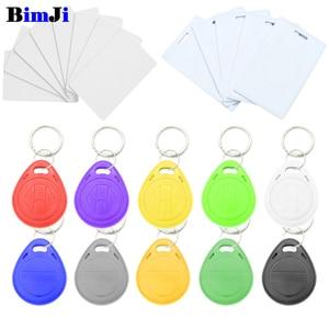 Image 1 - 50pcs/lot 125khz T5577 EM4305 RFID Blank Key Tag Chip Ring Cards Tags Keytag Copy Rewritable Writable Rewrite Duplicate 125 khz