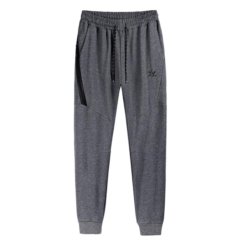 125 kg peut porter grande taille hommes pantalons 6XL 7XL 8XL Gym pantalons de survêtement hommes Zipper poche Fitness Sport pantalon homme course Jogging pantalon