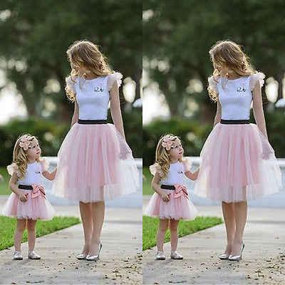 2 pcs ใหม่ขายร้อนแม่ลูกสาวเสื้อผ้าผู้หญิงแขนสั้นเสื้อยืดสั้นโบว์โบว์ Tutu กระโปรงฤดูร้อนการจับคู่ชุดอินเทรนด์