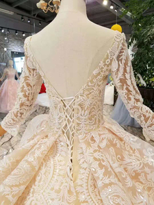 Image 5 - LS11003 champagne lace wedding dresses 2020 square neck see through long sleeves sexy v back wedding gown with shiny long train