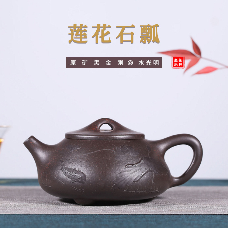 Raw Ore Enameled Pottery Teapot Light On The Water Clear Lotus Stone Drum Black Gold Just Teapot Direct Selling Teapot Tea SetRaw Ore Enameled Pottery Teapot Light On The Water Clear Lotus Stone Drum Black Gold Just Teapot Direct Selling Teapot Tea Set