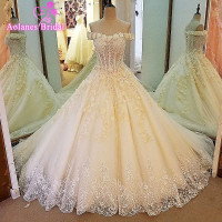 Gorgeous Ball Gown Lace Up Back Arabic Wedding Dresses 2017 Puffy Lace Applique Sequins Sleeveless Wedding Gowns Robe De Mariage
