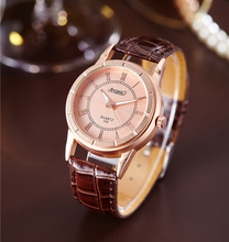 2016 New Style Casual Watch Women Rose Gold Color Dial Leather Strap Roman Numerals Women Dress Watches Lady Quartz Wristwatch