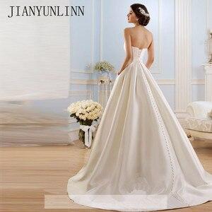 Image 2 - קו שמלות כלה 2020 בציר כיסי קשת סין Vestidos דה Novia ללא משענת בתוספת גודל כפתור הכלה כלה שמלות