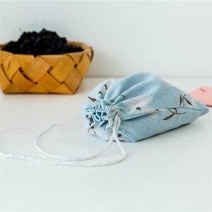 Image 2 - Polyester coton panier de rangement voyage lavage poche chaussure tissu stockage panier sacs Portable organisateur pratique voyage stockage
