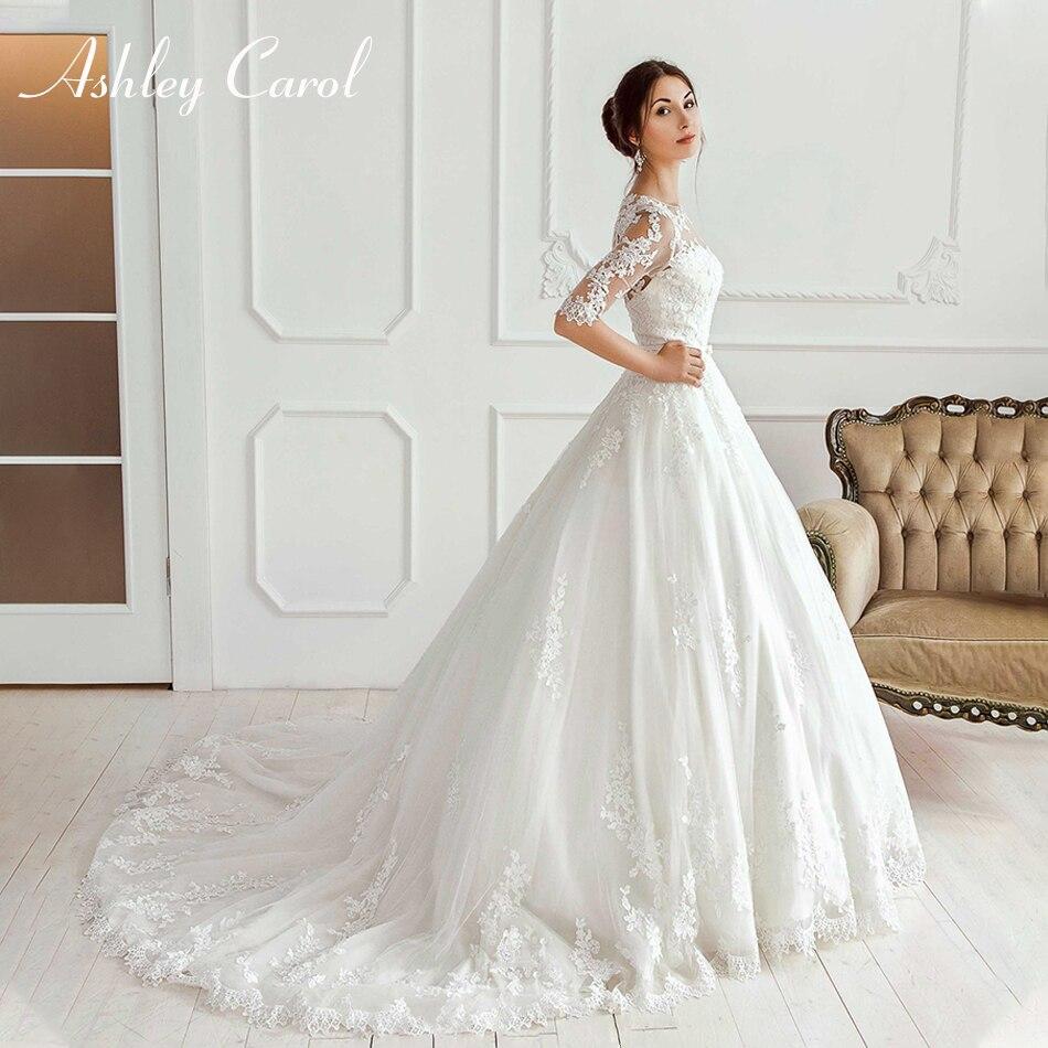 Ashley Carol élégante Scoop Illusion demi manches princesse robe de mariée 2019 nouveauté arc robe de mariée robes de mariée Vintage