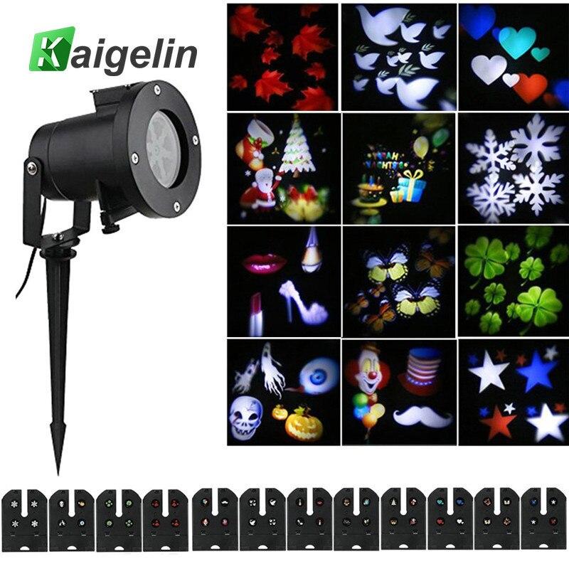 цена Holiday LED Projector Christmas Decoration Light 12 Pattern Slides Outdoor Garden Waterproof LED Stage Light Snow Projector онлайн в 2017 году