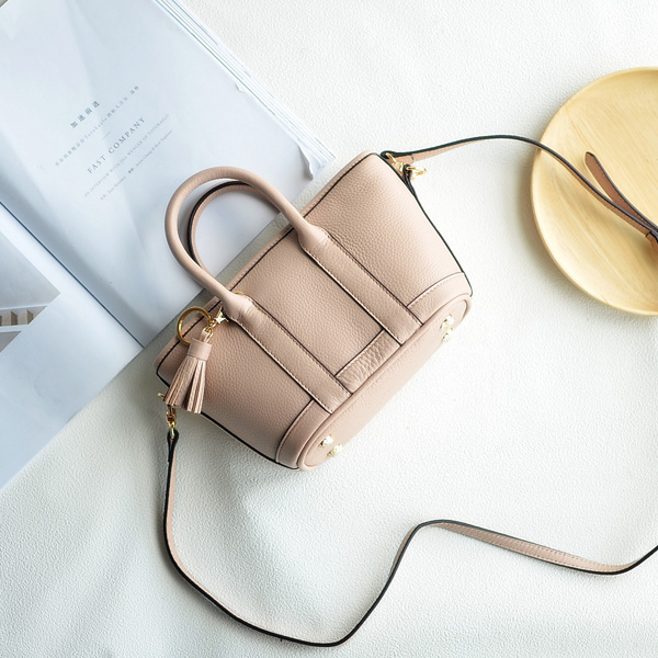 Europe and the new spring and summer leather handbag bag simple cross head layer cowhide temperament
