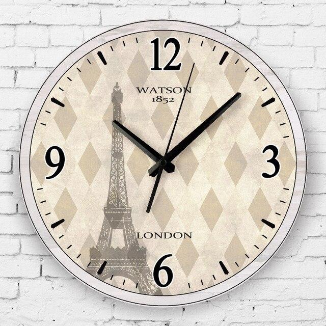 46fca3e74 جنوب شرق آسيا نمط الديكور ساعة الحائط غرفة الاجتماع برج ايفل الجدار الديكور  ساعة الصامتة خمر