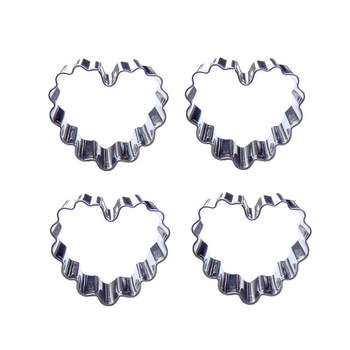 A forma di cuore a forma di 4 pezzi cookie stampi taglio, attrezzi di cottura, strumenti di decorazione di una torta molle della caramella.