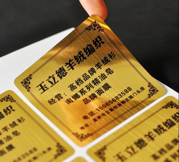 Autocollant fait sur commande d'étiquette de couleur d'or de style de tréfilage, surface luxueuse de paillasse d'aspect, article No. CU56