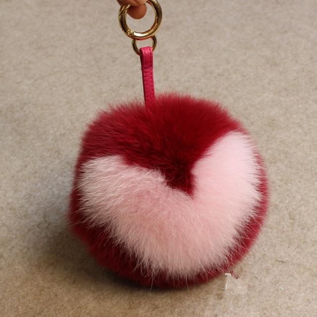 Llavero piel verdadera cadena de pom pom de la bola del melocotón bolso de la personalidad moda colgante llavero en forma de corazón encargo zorro del bolso de hombro
