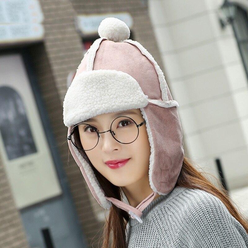 50f1fdab95d MingJieBiHuo Cute ball lamb wool hat Korean version of the tide warm  earmuffs solid color cotton small women girls Bomber Hats
