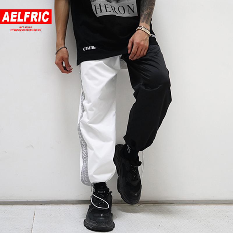 AELFRIC Black and White New Design 3M Reflective Letter Harem Pants Men Women Summer Hip Hop Casual Joggers Tide Streetwear ZY26