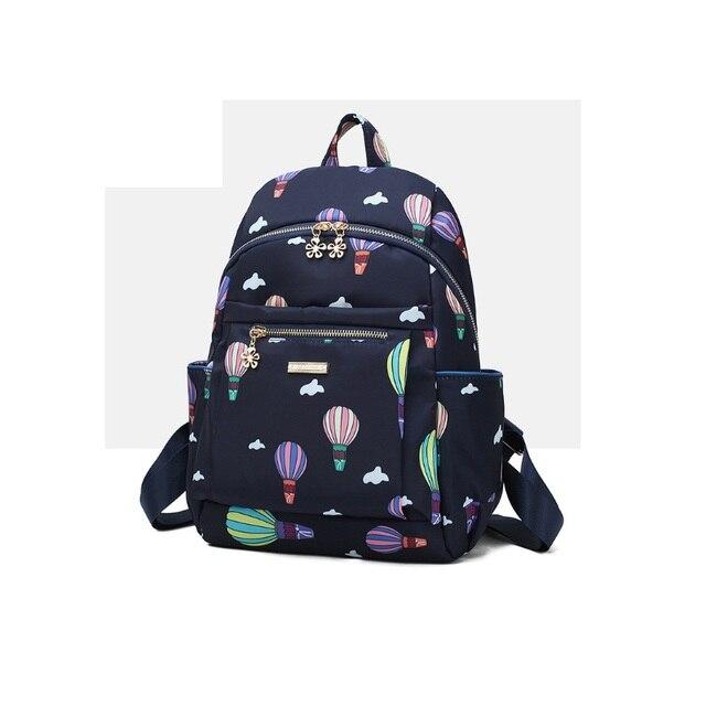 a7dcba8300 Nouveau 2019 femmes jeune fille voyage impression fleur sac à dos fille  emoji sac toile kawaii