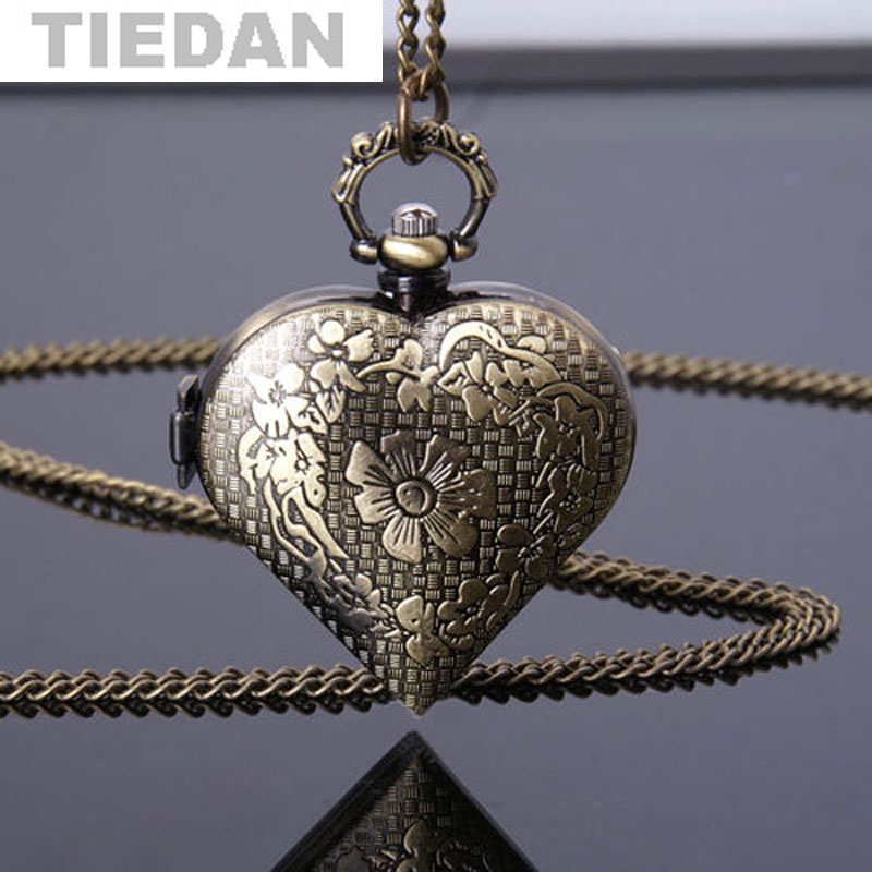 Reloj de bolsillo de bronce hueco en forma de corazón antiguo de las - Relojes de bolsillo