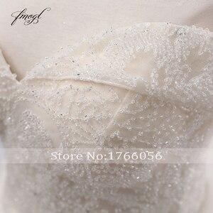 Image 5 - Fmogl Vestido דה Noiva סירת צוואר כדור שמלת חתונת שמלות 2019 סקסי ללא משענת חרוזים קפלת רכבת תחרה בציר כלה שמלה