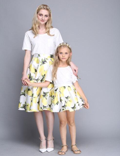 Летний новый Европейский Американский Мода Дети Желтый Цветок Печатных Юбки Мама и Я Онлайн Хлопок Юбки Мать Дочь Одежда