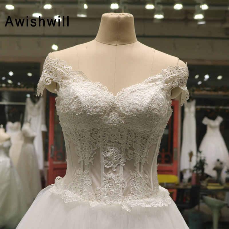 מדהים עצמות מחוך חתונת שמלה עם תחרה Vestido דה Novia קפלת רכבת שווי שרוול נדל תמונת שמלות כלה