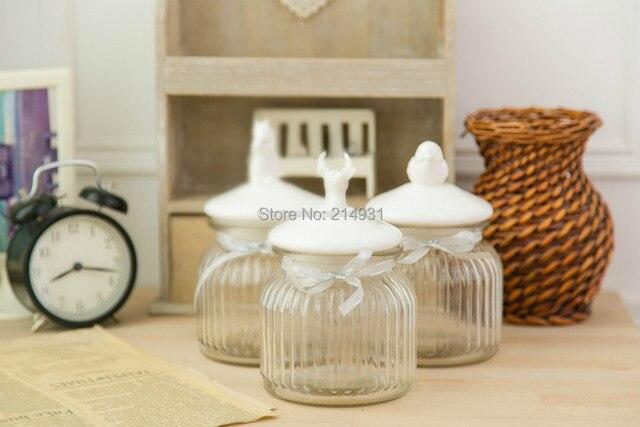 Piccolo stile country americano vaso di vetro con uccello in ...