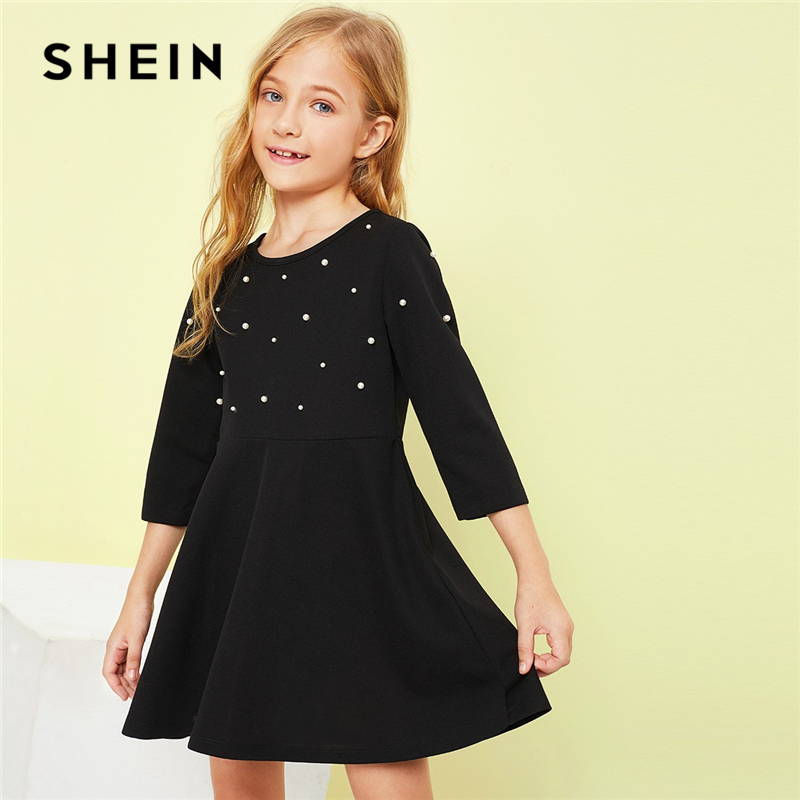 SHEIN Kiddie Black Solid Girls Pearl Beading Flare Casual Dress Children Clothing 2019 Spring Fashion A Line Cute Short Dresses trendy boat neck cap sleeve floral print a line zipper women dress