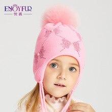 ENJOYFUR invierno Fox Fur Pompom sombrero niños niñas Rhinestones Arco-Nudo  patrón Beanies caliente otoño niños Caps 88cb073d61e
