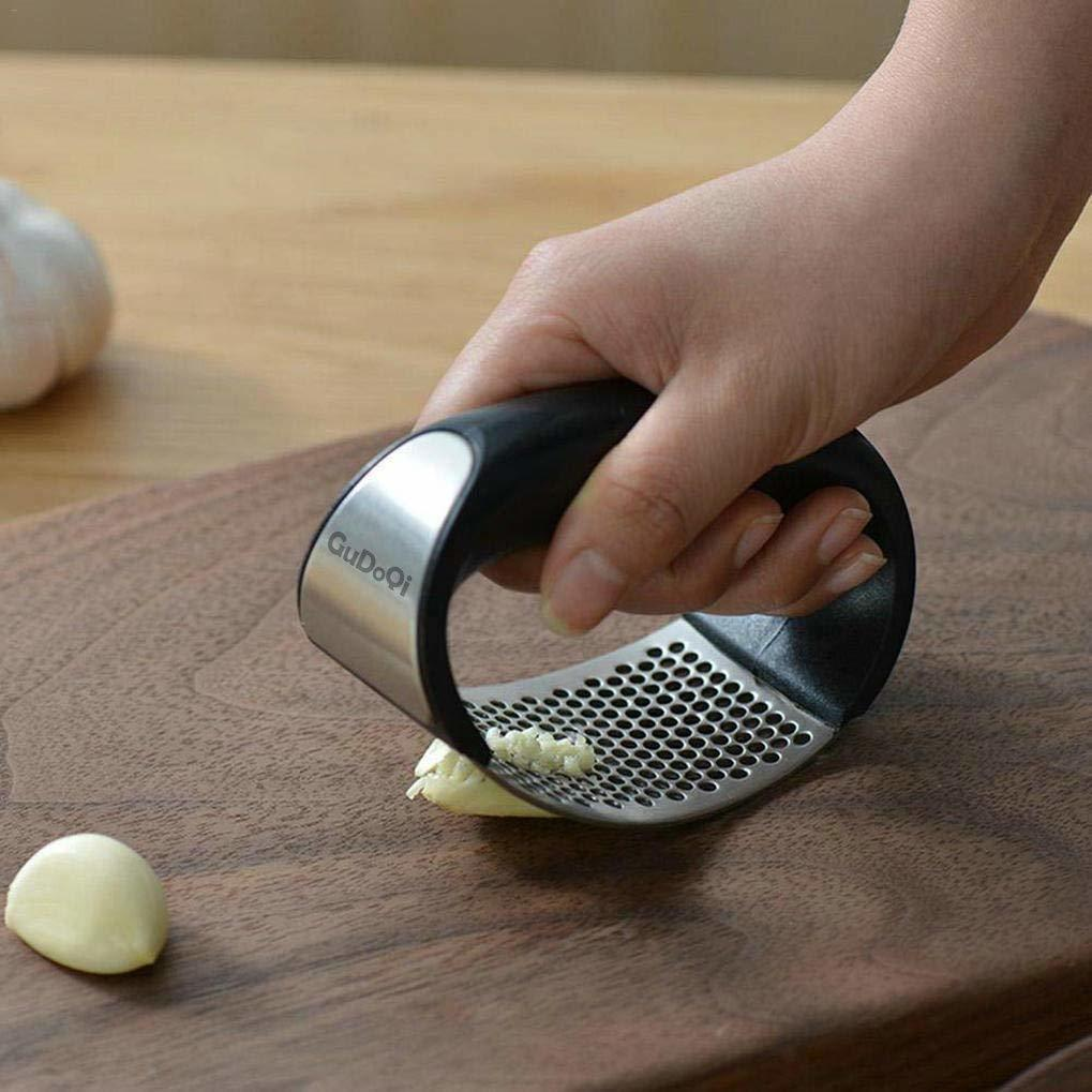 Garlic press rocker stainless steel ginger grinder squeezer kitchen gadget with ergonomic handle silicone tube garlic peeler and cleaning brush tool kit
