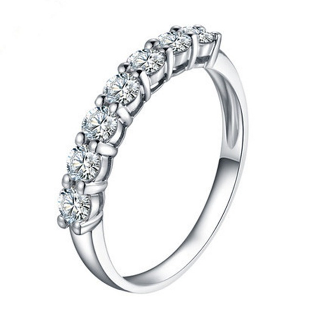 f0b2791211cc Marca personalizada anillo 0.7ct diamantes sintéticos anillo de compromiso  boda anillo siete Piedras anillo plata