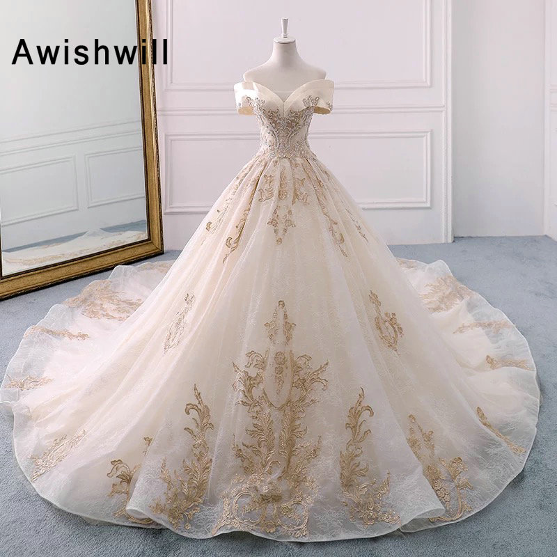 Romantic Off The Shoulder Beaded Lace Wedding Dresses Princess 2019 Chapel Train Champagne Wedding Gown Vestido de Noiva